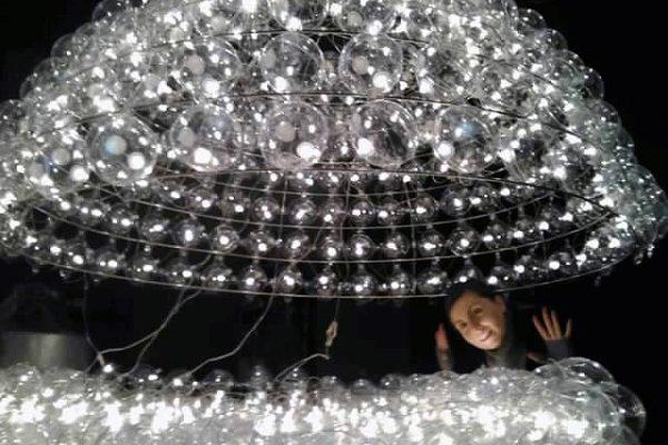 working on custom-made big ball chandelier